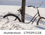 Parked Bicycle Covered In Snow...