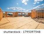 Small photo of A new construction home being framed on a hillside with a view overlooking Spokane Valley, Washington