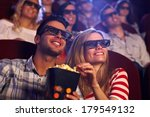 happy couple sitting in movie... | Shutterstock . vector #179549132