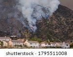 A Wildfire Burns The Hillside...