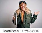 Young Beautiful Skier Woman...