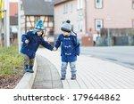 two little sibling boys walking ... | Shutterstock . vector #179644862