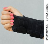 Small photo of Wrist brace for the treatment of carpal tunnel syndrome or median nerve compression, numbness hand