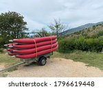 Trailer With Kayaks Near River...