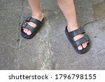 Feet Of A Boy Wearing Sandals...