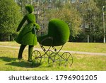Topiary Sculpture Of Mother...