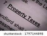 Small photo of The letters of property taxes clause of the lease agreement in heavy vignette. The landlord usually shift the taxes burden to the tenant through contractual mechanic.