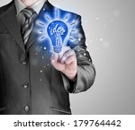 business man touching light of... | Shutterstock . vector #179764442