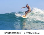 surfing a wave | Shutterstock . vector #179829512