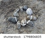 Pebbles In A Circle On A Beach...