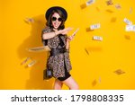 Small photo of Photo of crazy positive girl spend waste hundred dollars credit bank earnings air fly money isolated over bright shine color background wear headwear skirt sunglass