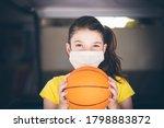 Young Girl Wearing Mask Playing ...