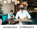 Beautiful Young Waitress With...