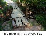 A Dilapidated Wooden Bridge...