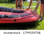 Red Rubber Boat Is Inflated...