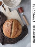 Small photo of greshli baked homemade sourdough bread with banetton and bread lame knife