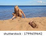 Blond Boy Is Buried In The Sand ...