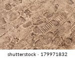 Brown Road Dirt With Footprints....