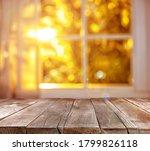 Empty Wooden Table Near Window...
