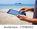 Hands With Tablet On The Beach
