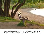 Empty Wooden Bench On The Bank...