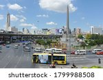 Small photo of Bangkok, Thailand - Nay 8, 2013:Traffic passes through the city centre and Victory Monument. Victory Monument commemorates Thailand's victory in the 1941 Thai-Franco War.