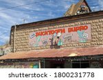 Small photo of Oatman, AZ / USA – October 12, 2016: A view of the Bucktooth Burro gift shop sign in the Route 66 tourist town of Oatman, Arizona.