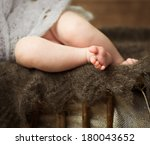 Legs Of A Newborn Girl Sleepin...