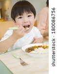 japanese boy eating curry rice   Shutterstock . vector #180086756