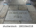 Small photo of Plymouth England. August 2020. Large granite stone with MAYFLOWER 1620 thereon in footpath alongside the Mayflower steps, Barbican, where the Pilgrim fathers embarked for the New World September 1620