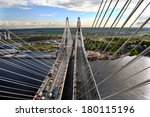St-Petersburg, Russia -  August 31, 2007: Construction of the second part of the cable-stayed bridge, car traffic in the first part of bridge. Vansu Bridge across Neva River, is part of a ring road - stock photo