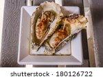 big oysters at miyajima  japan. | Shutterstock . vector #180126722