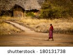 Massai Warrior Walking Through...