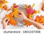 Woman Hands Makes An Autumn...
