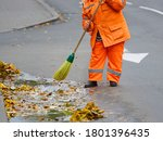 Worker Cleaning Street With...