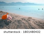Small photo of 30th of Nay 2016: Nha-Trang, Vietnam - boy is lying on a beach buried in the sand