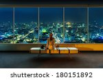 woman looks at night cityscape | Shutterstock . vector #180151892