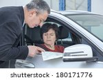 woman with car and map asks for ... | Shutterstock . vector #180171776