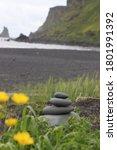 Dark Sand Beach And Cliffs With ...