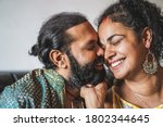 Small photo of Indian husband and wife having tender moments - Portrait of happy southern asian couple - Love, ethnic and india's culture concept - Focus on woman eye