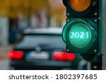Small photo of A city crossing with a semaphore. Green light with text 2021 in semaphore. New Year background concept