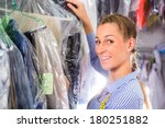 female cleaner in laundry shop...   Shutterstock . vector #180251882