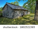 Small photo of An old weathered timber residential house with greyed wooden roof from one of Turku archipelago island at summer day. Finland.
