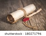old scroll paper on wooden... | Shutterstock . vector #180271796