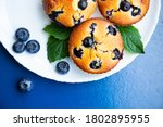 Blueberry Muffins In White...