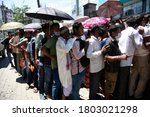 Small photo of Guwahati, India. 25 August 2020. People flout social distancing norms as they stand in a queue to register for Aadhar cards, amid the ongoing COVID-19 coronavirus pandemic, in Guwahati.