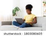 African Teen Girl Using Laptop...
