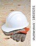 Work Gloves & Hard Hat on Wood Background - stock photo