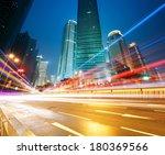 the light trails on the modern... | Shutterstock . vector #180369566