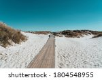 Wooden Pathway On The Beach...